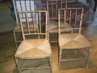 a pair of original painted bamboo chairs