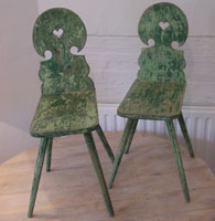 pair of painted folk chairs